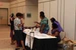 Attendees sign guestbook, pick up name tags, tee-shirts and goody bags