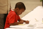 Dillan signing the guest book(From the pen of Bettie Griggs, Family Historian. This is my favorite picture. Dillan will